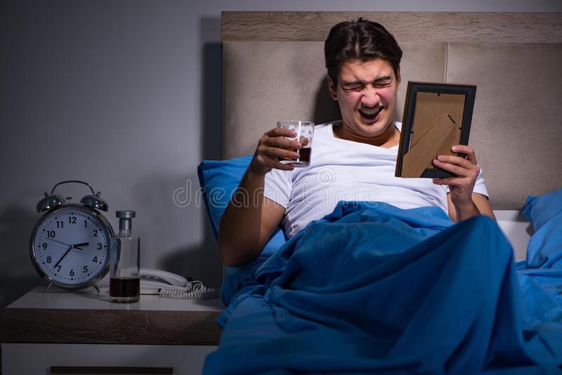 The desperate man divorced in bed. Desperate man divorced in bed stock photo