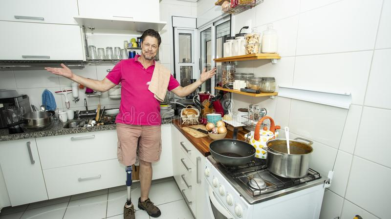 Desperate man in the kitchen, Cleaning concept stock photo