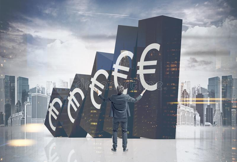 Desperate man looking at falling Euro graph. Desperate young businessman looking at falling graph with Euro signs on it in modern city. Concept of financial stock images