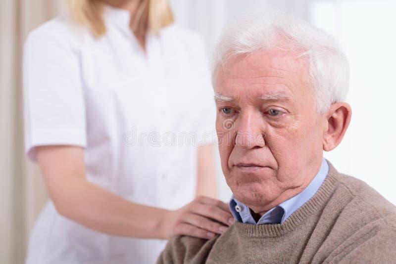 Desperate sad pensioner royalty free stock image