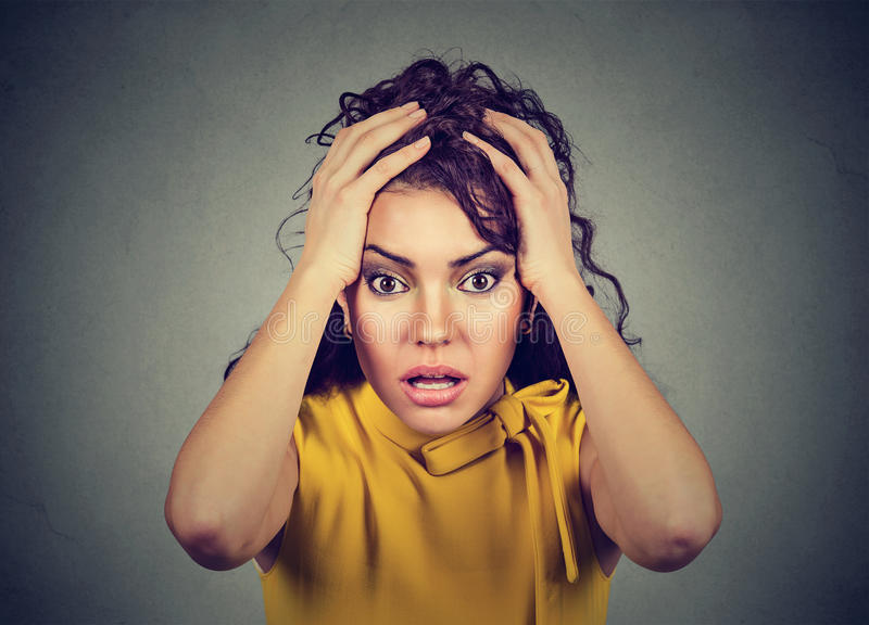 Desperate stressed worried woman with hands on head royalty free stock photography