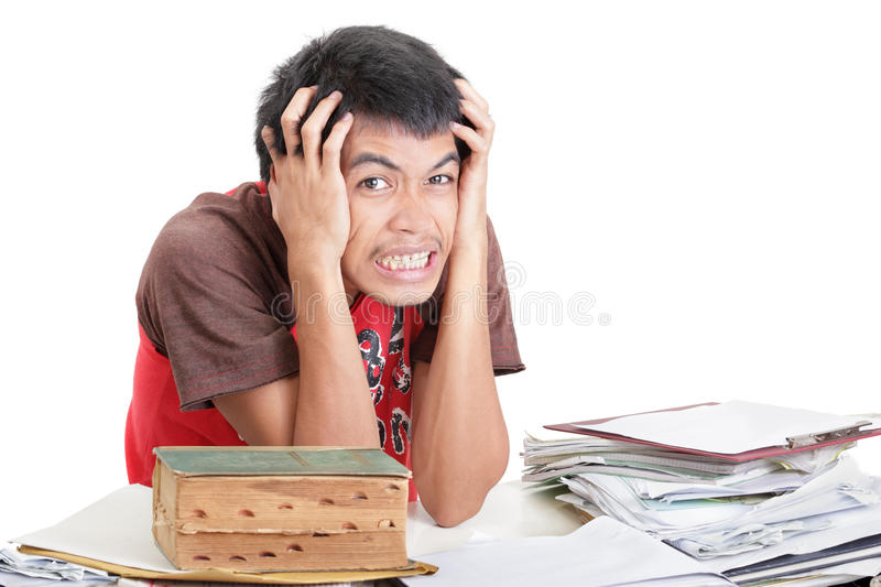 Desperate student over notes stock photography