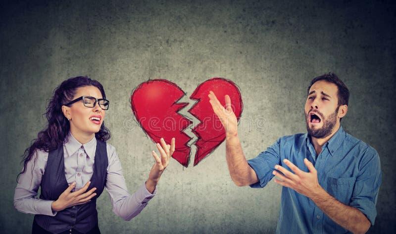Desperate young heartbroken couple man and woman stock photos
