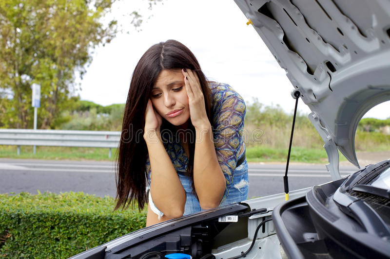 Download Desperate Woman Looking At Broken Engine Stock Photo - Image: 27873188