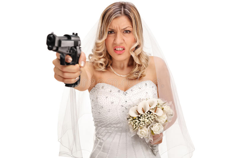 Desperate young bride holding a gun royalty free stock image