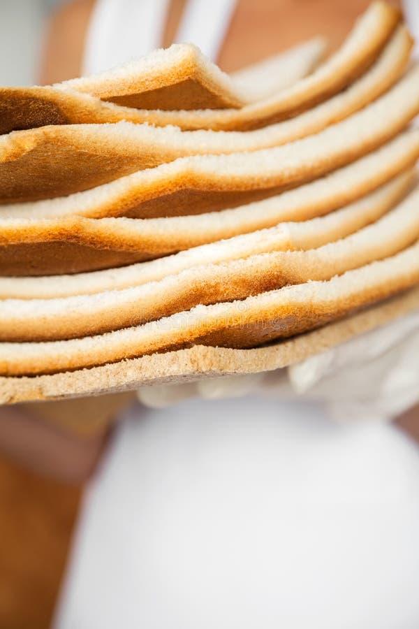 Desperdício do pão na padaria imagens de stock