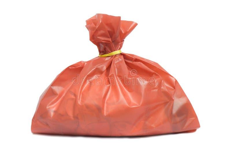 Desperdícios infecciosos no saco vermelho fotografia de stock
