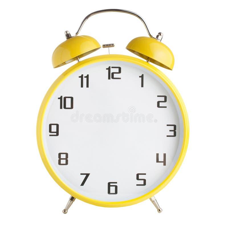 Despertador amarelo sem as mãos isoladas no fundo branco imagem de stock