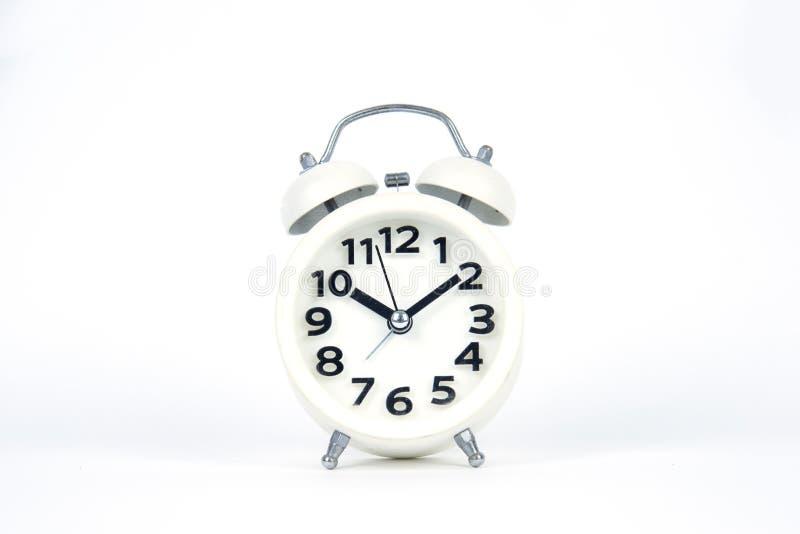Despertador branco fundo branco isolado fotografia de stock royalty free
