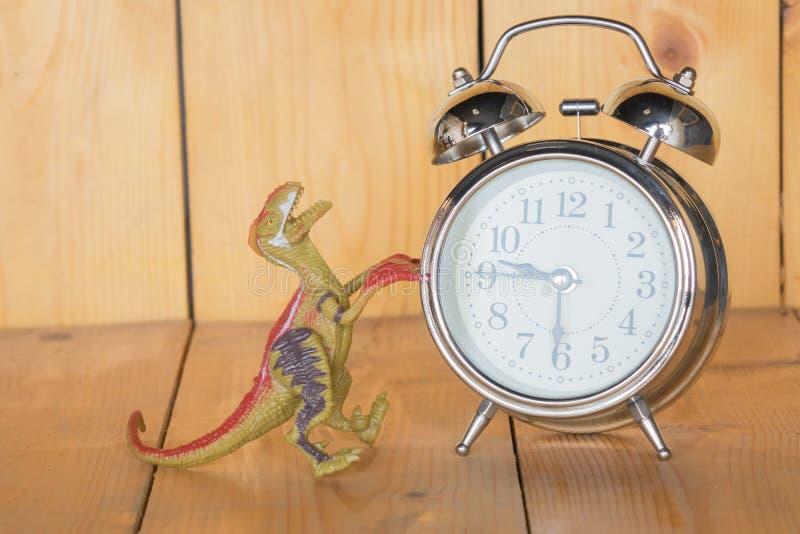 Despertador, dinosaurio fotografía de archivo libre de regalías