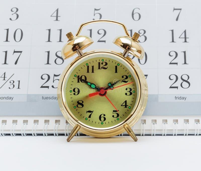 Despertador e calendário fotos de stock