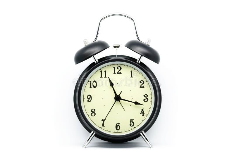 Despertador preto no fundo branco imagem de stock royalty free