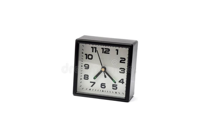 Despertador preto no fundo branco com sombra fotografia de stock royalty free