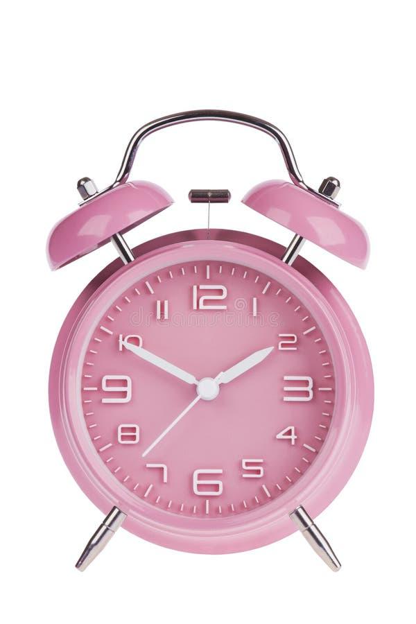 Despertador rosado aislado en blanco foto de archivo libre de regalías