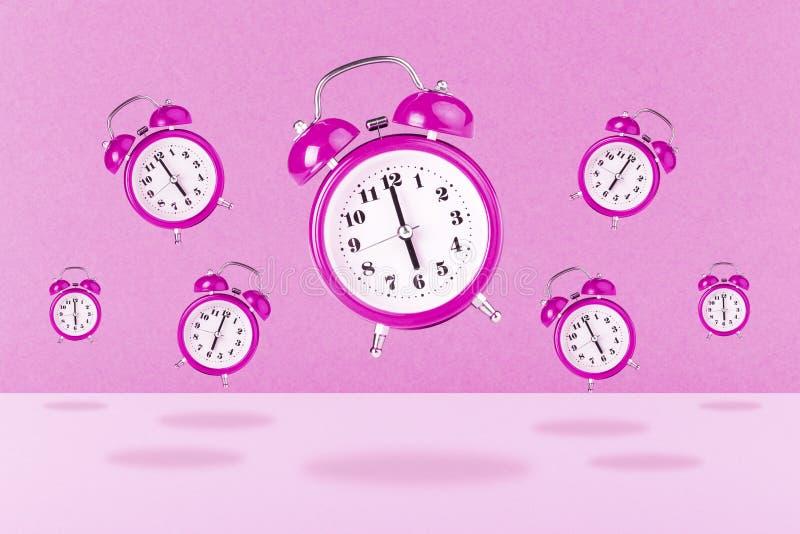 Despertadores cor-de-rosa imagens de stock