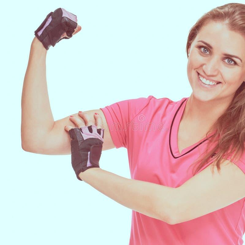 Desportista que mostra o bíceps fotos de stock royalty free