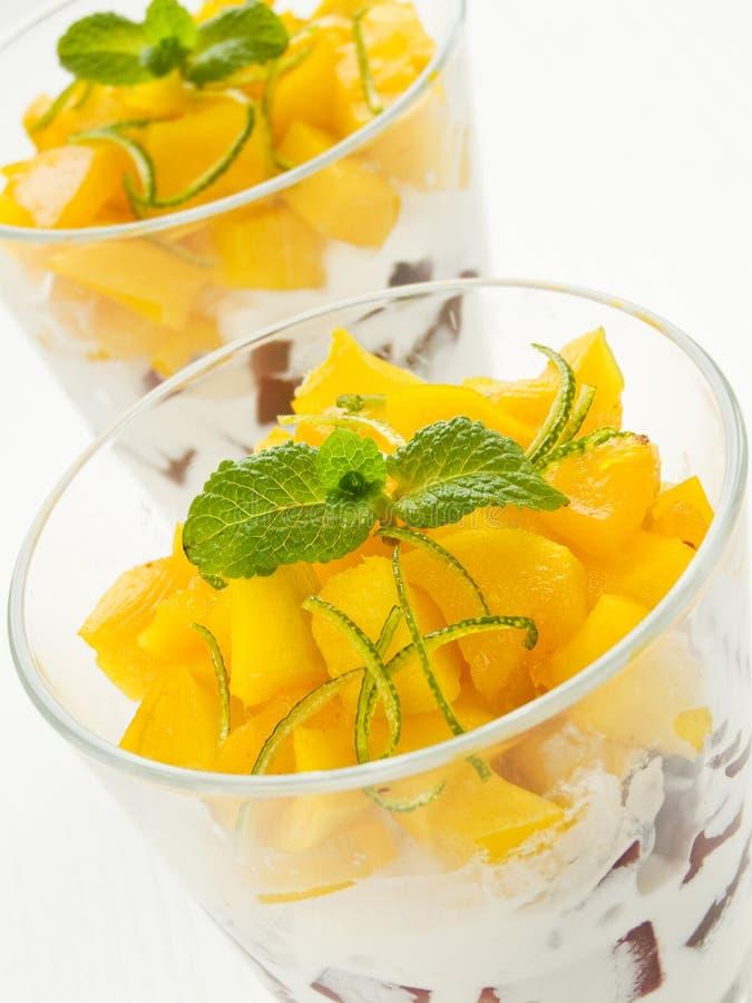 Dessert. Of mango, pears and ice cream. Shallow dof royalty free stock photography