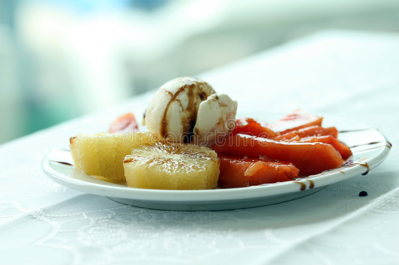 Dessert. Ice-creme dessert with fresh fruits on the plate stock photos