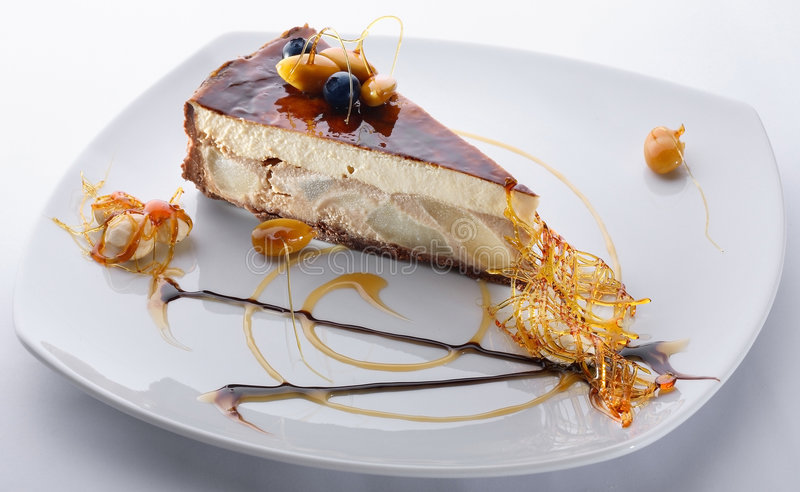 Dessert. On a dish on a white table-cloth royalty free stock photography