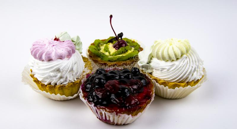 Dessert - baskets with cream, cherry, kiwi, raspberry, currant, blueberry stock images
