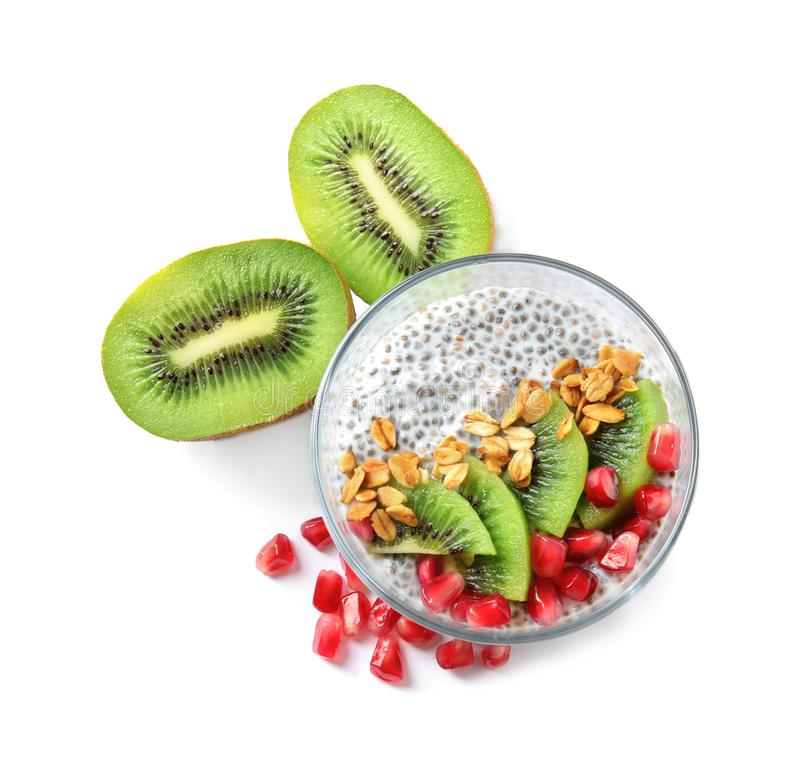 Dessert bowl of tasty chia seed pudding with granola, kiwi and pomegranate royalty free stock photography