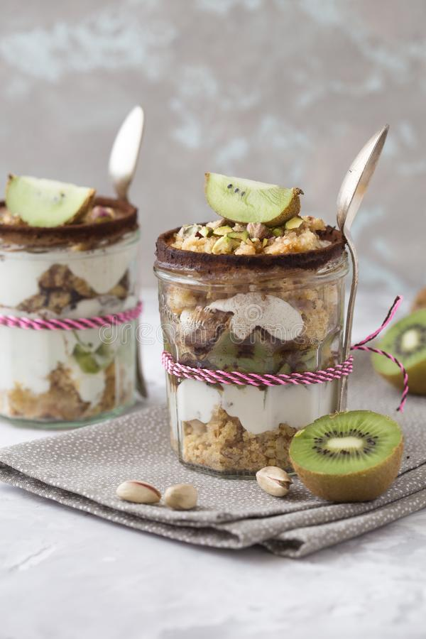 Dessert bowl with tasty parfait on table. apple crumble, kiwi, Greek yogurt. parfait , parfait , parfait ,parfait stock image