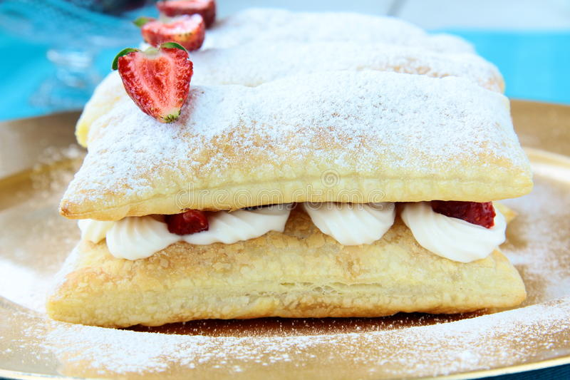 Dessert cake of puff pastry, whipped cream stock images