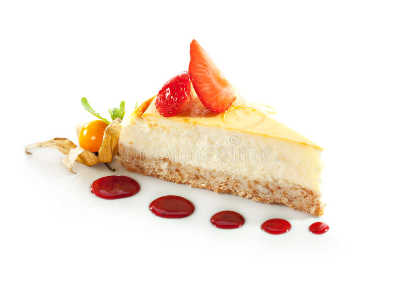 Dessert - Cheesecake. With Berries Sauce and Green Mint royalty free stock photos