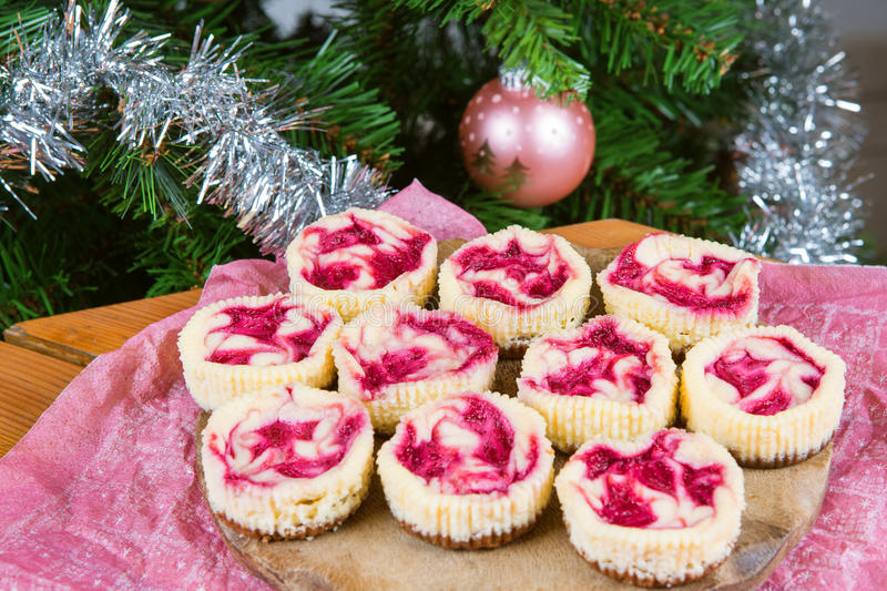 Dessert for Christmas. Mini raspberry cheesecakes in muffin form royalty free stock photo