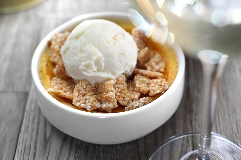 Dessert of cream brulee with ice cream and sesame in caramel royalty free stock image
