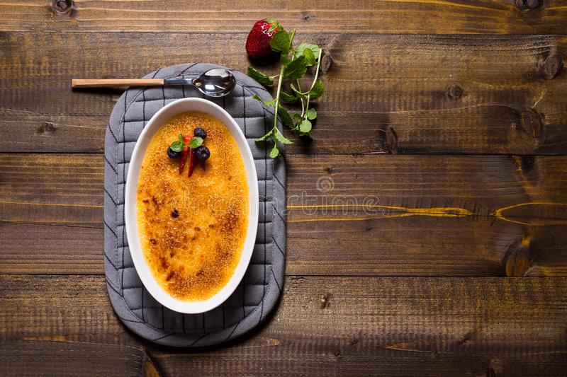 Dessert Creme Brulee with Strawberry, Blueberry and Fresh Mint Leaves. Dessert Creme Brulee with Strawberry, Blueberry and Fresh Green Mint Leaves stock images