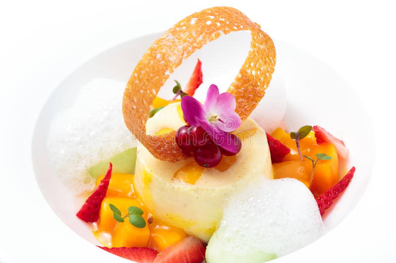 Dessert. Curd cheese dessert with fruits and berries stock photos