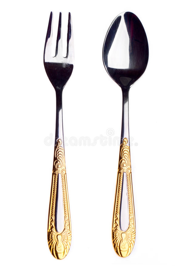 Dessert flatware. Fork and spoon on white background stock photography