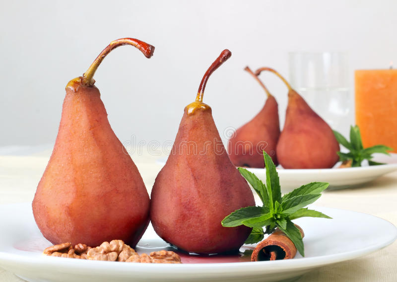 Dessert from a pear. Dessert from pears in red wine and a syrup royalty free stock photos