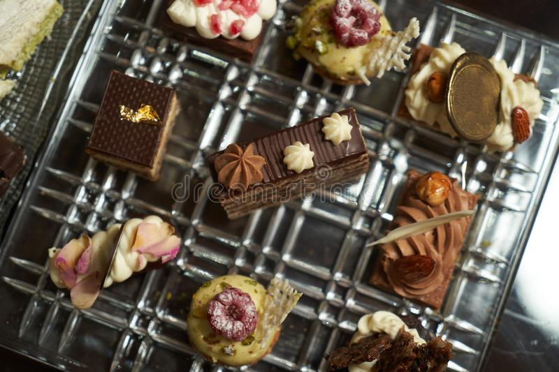 Dessert plate with assortment of sweets, piece of cake, cookies, biscuits. Close-up royalty free stock photo