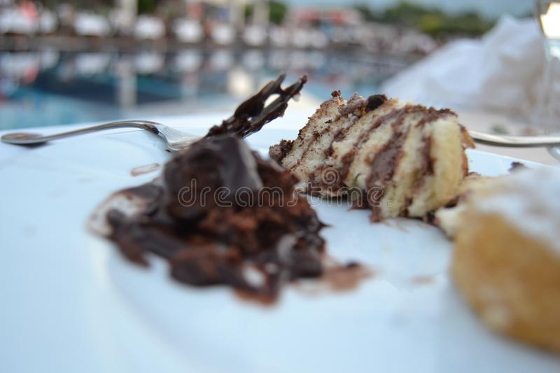 Dessert plate beside pool. Dessert plate in front of pool in hotel in Kemer, Turkey royalty free stock photography