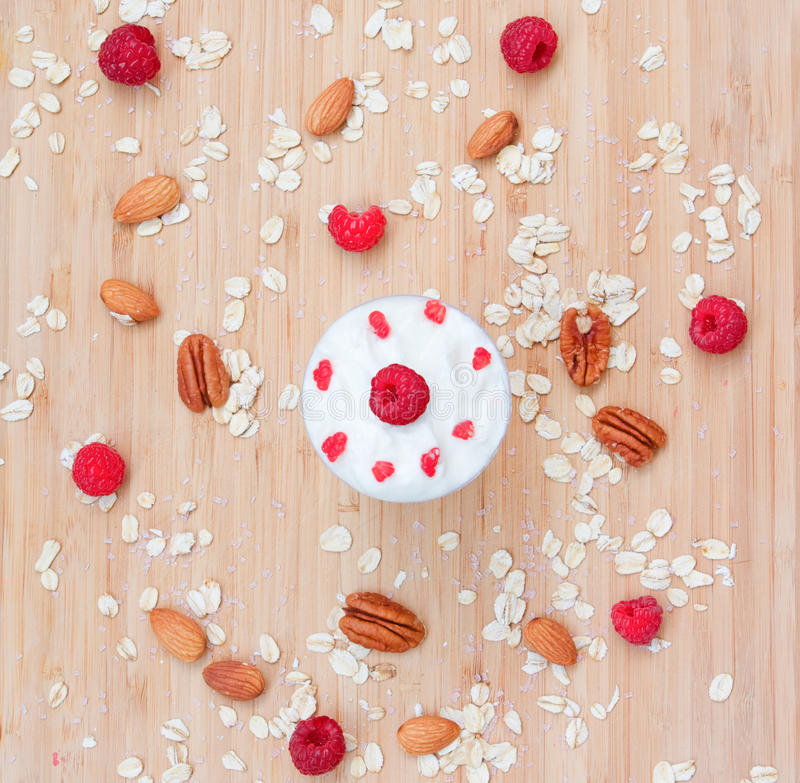 Dessert of raspberries, oats, nuts royalty free stock photography