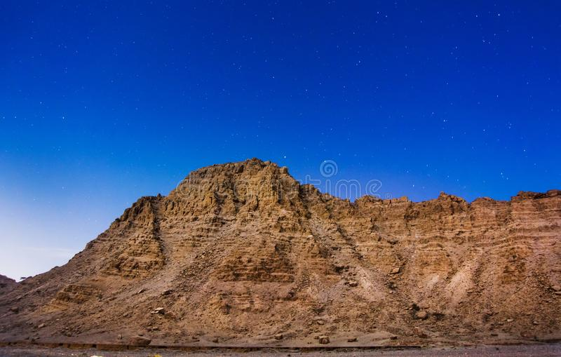 Dessert rock and stars at night royalty free stock photography