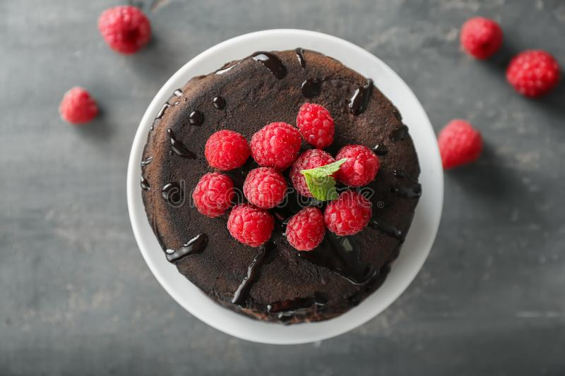 Dessert stand with tasty chocolate pancakes and raspberries on table, top view royalty free stock image