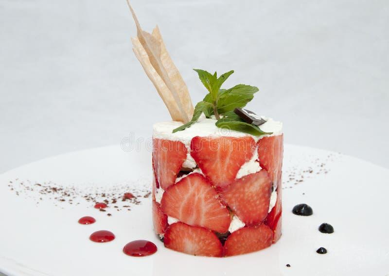 Dessert su una tavola con tè immagine stock