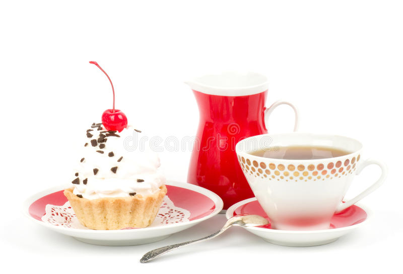 Dessert - sweet cake with cherry. On a plate on background stock image