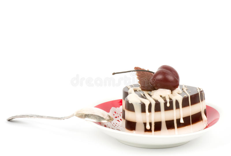 Dessert - sweet cake with cherry. On a plate on background stock images