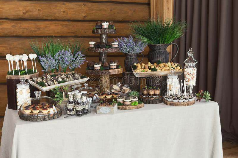 Dessert table for any holiday at wooden background royalty free stock photos