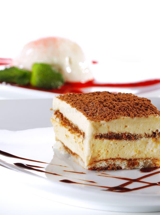 Dessert - torta di formaggio di Tiramisu fotografie stock libere da diritti