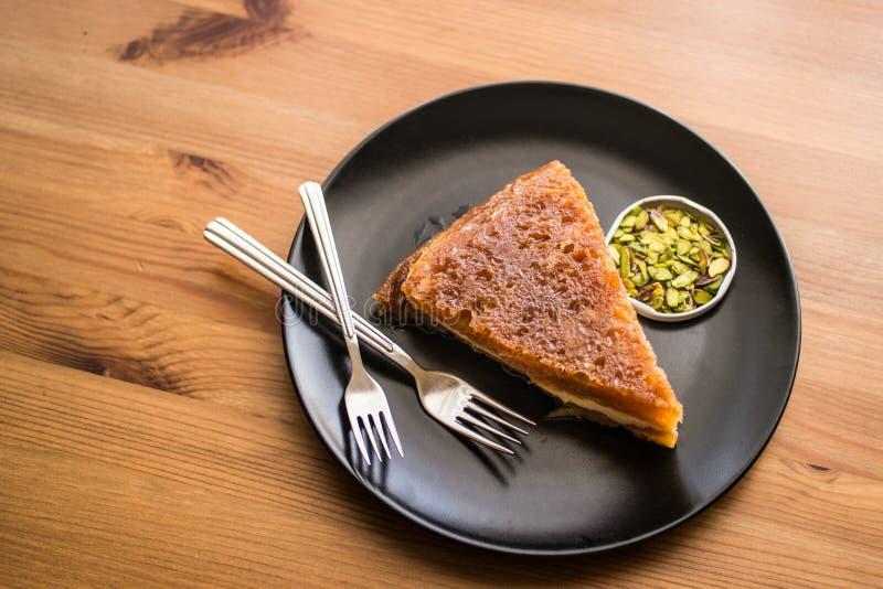 Dessert tradizionale turco Ekmek Kadayifi/budino del pane fotografia stock libera da diritti