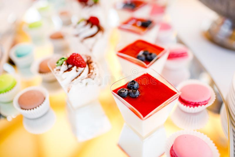 Dessert vanilla strawberry panna cotta. mousse cake with berries royalty free stock images