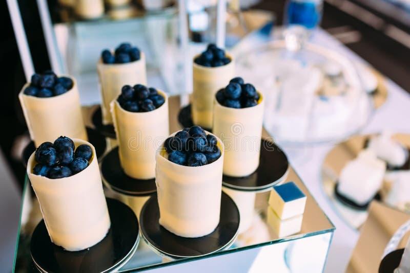 Dessert of white chokolate and blueberries. Sweet holiday buffet. Artwork stock photo