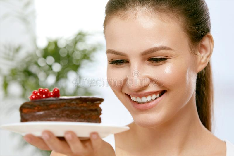 Dessert. Woman Eating Chocolate Cake. Portrait Of Beautiful Happy Smiling Girl With Piece Of Tasty Sweet Cake On Plate. Food And Nutrition Concept. High royalty free stock images