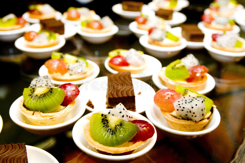 Desserts. There are different kind of desserts on the small dishes royalty free stock images