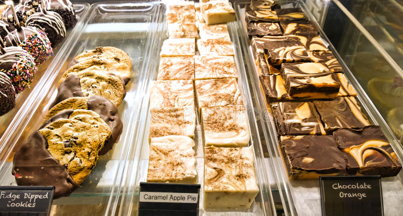 Desserts in a case. At a pastry shop royalty free stock photos
